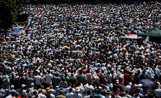 People attend a reburial ceremony of 136 newly identified victims in Potocari, near Srebrenica, Bosnia and Herzegovina July 11, 2015 (Reuters)