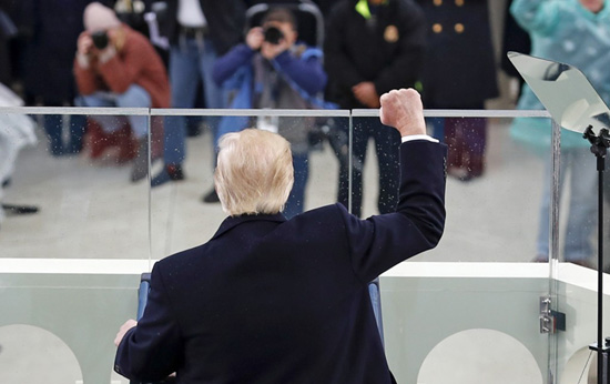 President Donald Trump raises his fist after speaking during the 58th Presidential Inauguration at the U.S. Capitol in Washington on Jan. 20, 2017. Photo: Carolyn Kaster/AP
